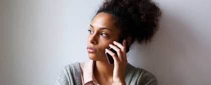 worried woman on cell phone